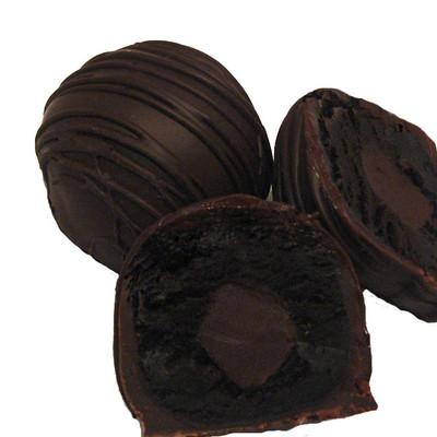 Dark Chocolate Dessert Truffles:  Our Dark Chocolate Dessert Truffle is chocolate through and through. Decadent, creamy chocolate cake is filled with smooth dark chocolate ganache and then drenched in Premium, European 60% Dark Chocolate.