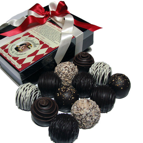 These expertly crafted truffles will delight the most sophisticated palate. Our Chocolate Dessert Truffles, take dessert to a whole new level.  Silky, smooth ganache is discriminatingly paired with a rich, creamy filling and ultimately embraced by Ultra-Rich Dark Chocolate.  Then, for the final sublime touch, we have adorned each one with its most complimentary flavor embellishment.