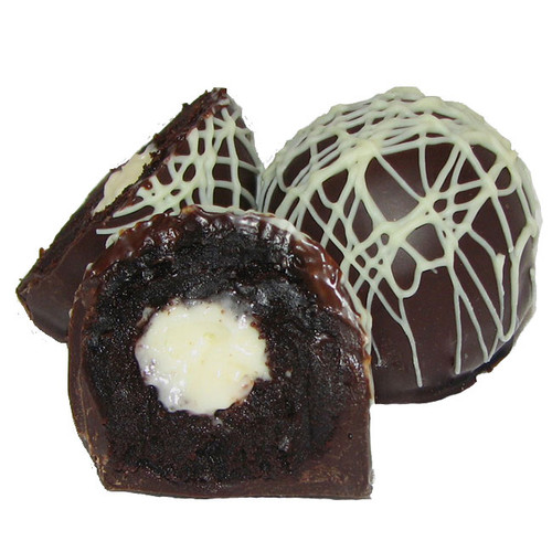 Our decadent chocolate ganache is filled with the lightest, creamiest Vanilla Italian Buttercream. All this lusciousness comes in a Premium, European 60% Dark Chocolate shell. Finally, in honor of such a festive celebration, we have drizzled the Birthday Cake Dessert Truffle with white chocolate.