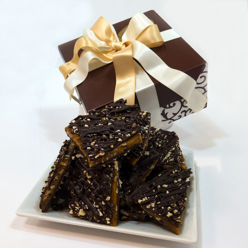 Our Dark Chocolate Pecan toffee is a Crunchy, Buttery Pecan Toffee has been drenched in Premium 60% Dark Chocolate, and then, for the perfect finishing touch, sprinkled with more pecans and drizzled with even more chocolate. 1 LB,  Pecan Toffee Gift box.