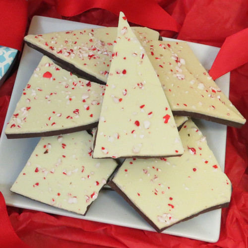 Our Peppermint Bark is a delicious holiday gift,  We craft our peppermint bark using the finest ingredients and hand-pack it into a reusable holiday gift box or gift bags . Creamy peppermint white chocolate layered over rich 60% dark chocolate and topped with crushed peppermint candy.  A delightfully sweet treat.