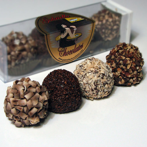 Chocolate Nut Dessert Truffle Assortment 4-piece: Silky, smooth ganache d is discriminatingly paired with a rich, creamy filling and ultimately embraced by Premium, European Chocolate.Then, for the final sublime touch, we have adorned each one with its most complimentary flavor embellishment.Our Chocolate Dessert Truffles, take dessert to a whole new level and presents to you a most magnificent confectionery experience.