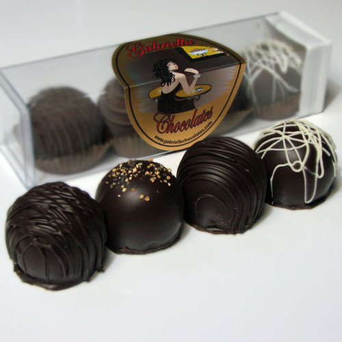 Silky, smooth ganache is discriminatingly paired with a rich, creamy filling and ultimately embraced by Premium, European Chocolate.  Then, for the final sublime touch, we have adorned each one with its most complimentary flavor embellishment.  Our Chocolate Dessert Truffles, take dessert to a whole new level and presents to you a most magnificent confectionery experience.