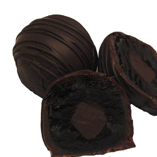 Dark Chocolate Dessert Truffles:  Our Dark Chocolate Dessert Truffle is chocolate through and through. Decadent, creamy chocolate cake is filled with smooth dark chocolate ganache and then drenched in Premium, European 60% Dark Chocolate.