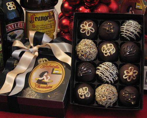 Our Spirited Dessert Truffle Collection will give you all the inspiration you need to kick off your evening right!  Imbibe on top-shelf liquors that have been generously paired with 60% Dark Chocolate, Creamy Cake Mousse flavors and sublimely complimentary centers.  No glass required; although, that would be a cute way to serve them.