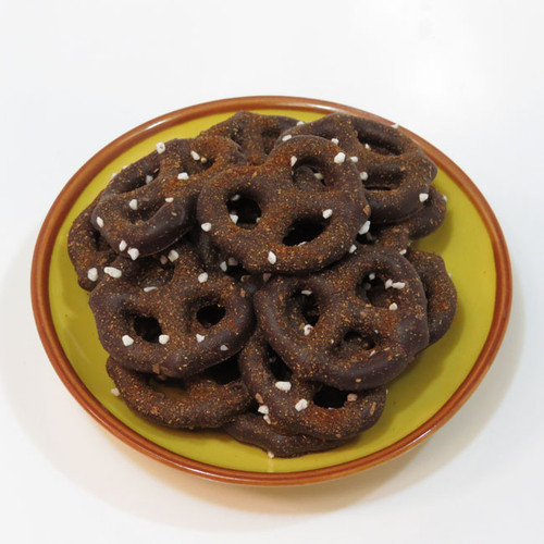 Sweet & Spicy Dark Chocolate Pretzels: 60% Dark Chocolate Covered Pretzels, sprinkled with smoky, Chipotle Pepper and sugar pearls. The Chipotle Pepper adds a little unexpected flavor to the chocolate pretzels, and is balanced by the addition of the sweet sugar pearls.