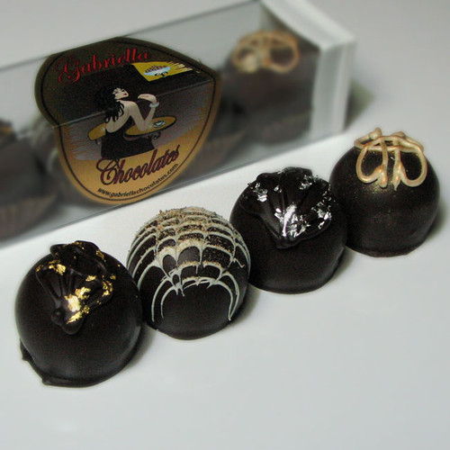 Our Spirited Dessert Truffle Collection will give you all the inspiration you need to kick off your evening right! Imbibe on top-shelf liquors that have been generously paired with 60% Dark Chocolate, creamy mousse flavors and sublimely complimentary centers. No glass required; although, that would be a cute way to serve them.
