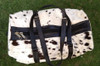 This cow skin leather bag is amazing The cowhide is beautiful. Craftsmanship is great comes with brand