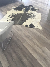 One of its kind four shades in a cowhide rug.