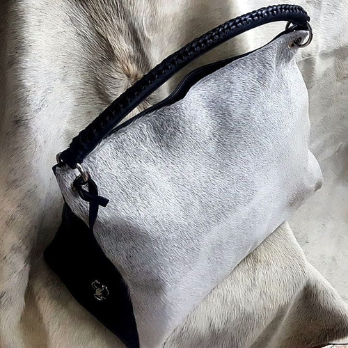 Grey White Cowhide Backed With Leather.
