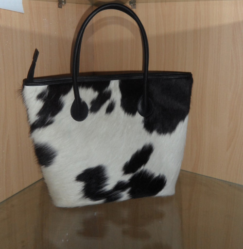 Large Black Spots On White Cowhide.