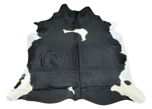 A Holstein cowhide rug in classic black and white spotted pattern for your home seems to go with the modern look that the designer wants to achieve.
