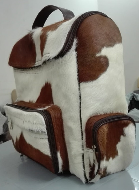 Handcrafted stunning cowhide backpack using unique brown white hide perfect as a diaper bag or large luggage for travel, high-quality straps and zips
