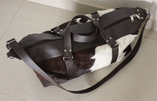 Cowhide Duffel bag in black and white, made from real hair on cowhide, this cow hide bags is perfect for travelling.