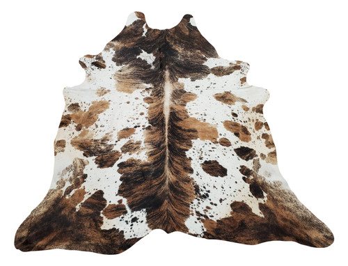A stunning Tri color cowhide rug large is an exotic mix of spotted speckled brown, black and white, this cowhide rug will look beautiful in the kitchen