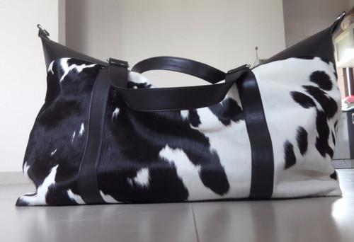 cowhide weekender bag black and white