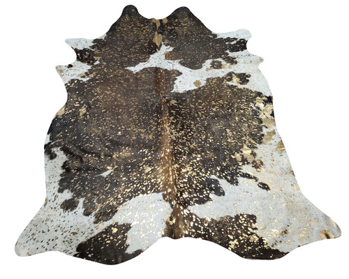 Metallic cowhide rugs go hand in hand with large sofa for cozying where you spend most of your evening, perfect shade, traditional and natural touch.