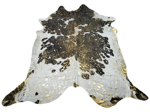 This gold metallic cowhide rug will look beautiful in open plan floor, it will solve the issue of space start and end, perfect for layering.