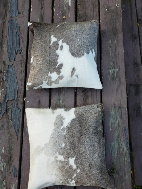 Two 20 X 20 grey cowhide cushion covers very soft and smooth.
