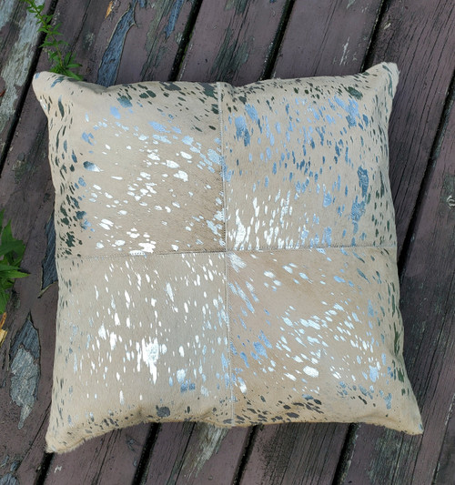 A stunning custom made extra large metallic gold cowhide cushion covers which will work in any ranch room.