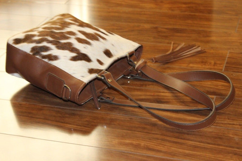 Nicely made cowhide messenger bag finished is very soft, smooth and real leather and it will serve you for a long time, also available custom fur purses
