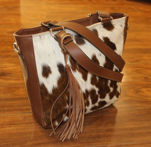 A unique cowhide tote bag in speckled brown white with premium leather handle.