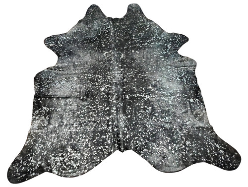 A very beautiful black cowhide rug washed in stunning silver metallic. This authentic cowhide is so beautiful it will go with most of the decor making it an exotic place, add it to a neutral living room or rustic style man cave, this piece of nature is one of its kind and very rare.