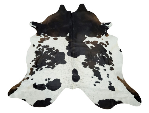 Adding large black white cowhide rug to living room can  drastically change the look of an interior, it will feel more open and balanced.
