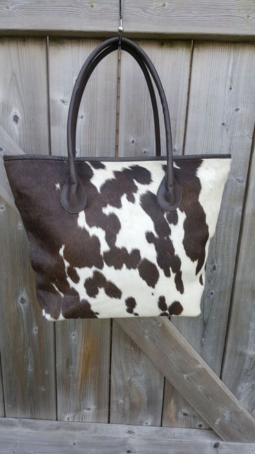 f42576814 Handmade Cowhide Leather Tote Bags In Assorted Patterns.