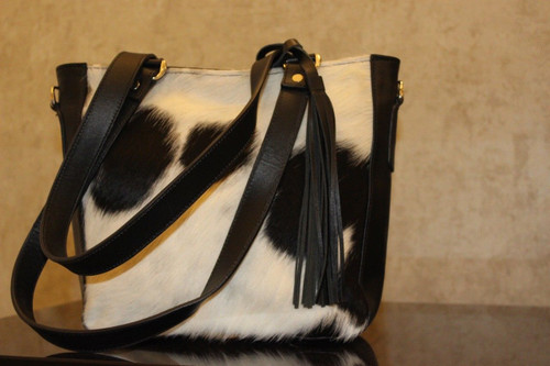 You will love this cowhide bag, we can also make makeup case in black and white to match you custom messenger bag, this is perfect for any day and event
