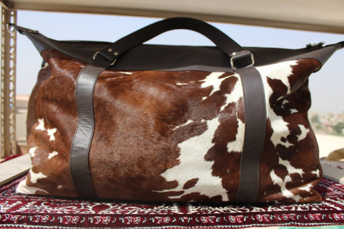 Brown And White Cowhide Duffel Bag