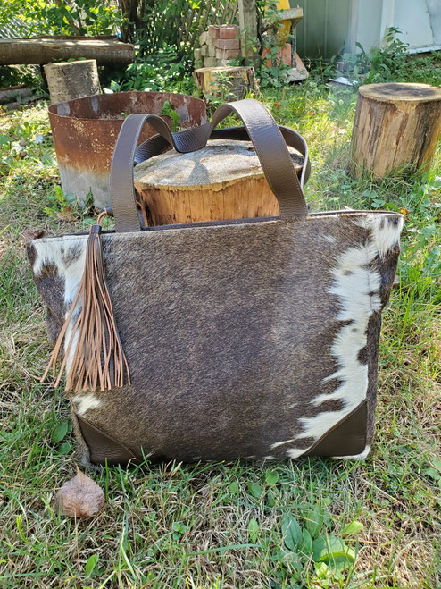Our new cowhide bag germany in black brown white from real natural cow skin vegetable tanned.