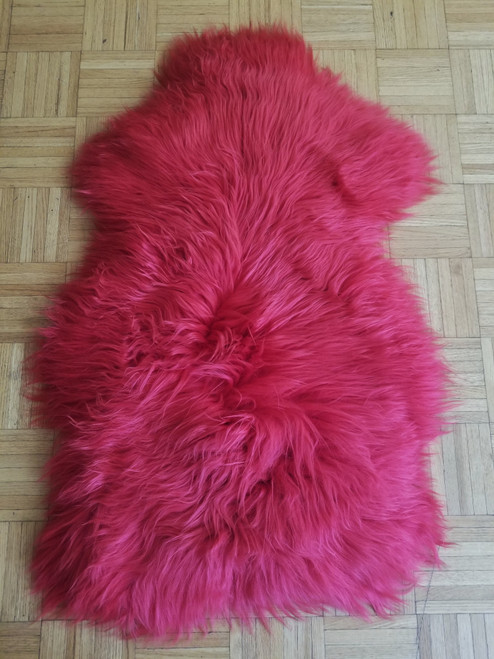 Burgundy pink sheep fur rug