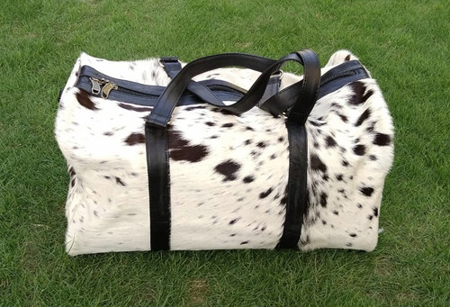 Fast shipping on all our beautiful cow skin bags in black white real cow skin,  definitely enjoy using this cow skin bag daily.