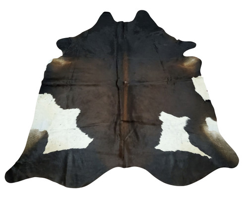 Exotic large cowhide rugs placed in your dining room or fireplace decor, it can be game changer, very soft and smooth with natural dark rich tones