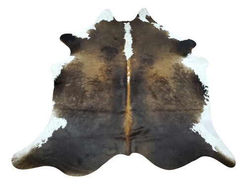 The soft sheen and exotic tricolor of this small cowhide rug touches a perfect spot of rustic and modern touch.