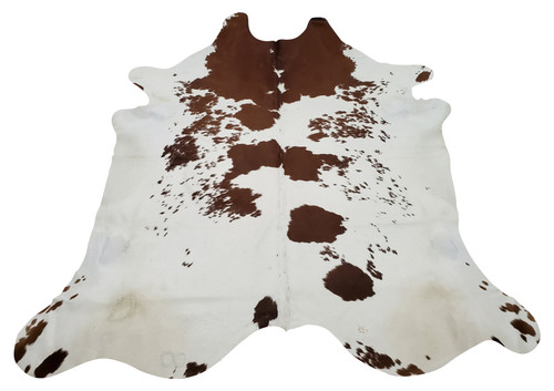 A cowhide rug to use for any event or space and you will love the natural marking, it will fit in almost any room, this brown white is gorgeous and huge.