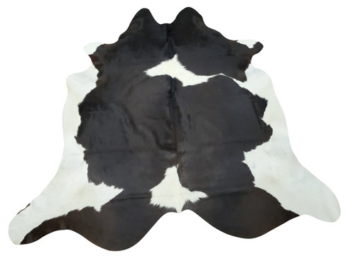 A natural cowhide rug in long hair will create the mood of your decor, very soft and smooth, these black white are art for your room