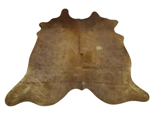 A new cowhide rug can add texture and personality to your interior, dark black and brown are great for fireplace or hallway.