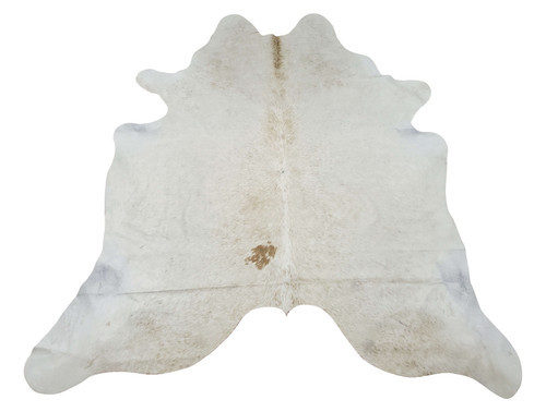 New small cream cowhide rug handpicked for the neutral pattern it will make living area charming