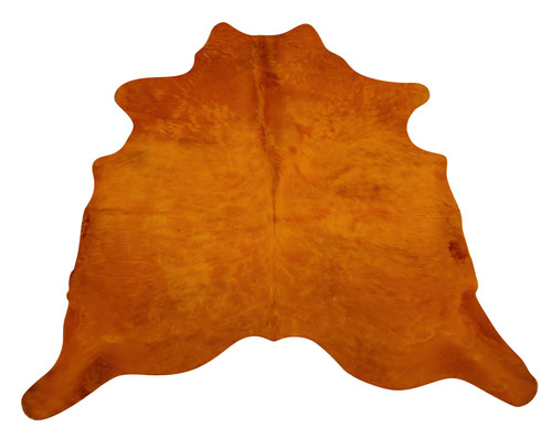 A coffee table and dyed cowhide rug in orange is what your decor need, very easy to clean and hard to stain.