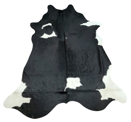 Beautiful natural cowhide rug in a exotic mostly black white white edges, it will add a unique taste to the room.