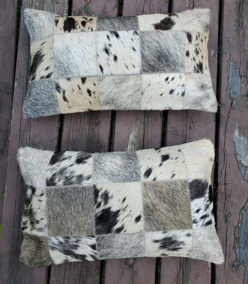 These lumbar cowhide pillows are gorgeous, the most beautiful shade of black grey cowhide fabric and very well made.
