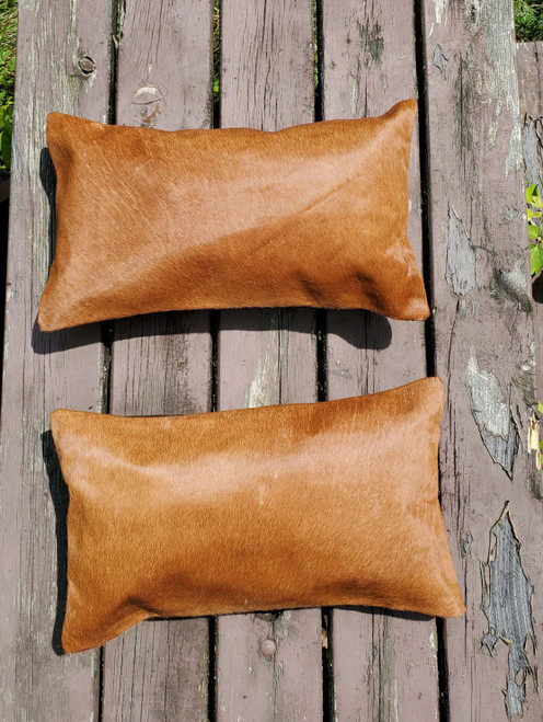 Loving this natural gorgeous cowhide lumbar pillow cover ! Looks even better in person, this will complete a mancave easily