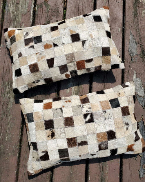 Fantastic cowhide pillow in lumbar style to work with, the thread and natural patchwork fabric is a wonderful spice to the decor.