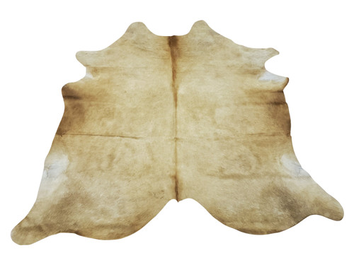 Add a cowhide rug to your work from home decor and Palomino is the perfect shade to give your space more groovy and interesting style.