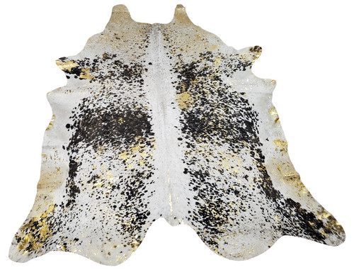 This metallic cowhide rug makes sure that the room looks as charming as the whole house, enough to spill out under the bed and a little chair leg.