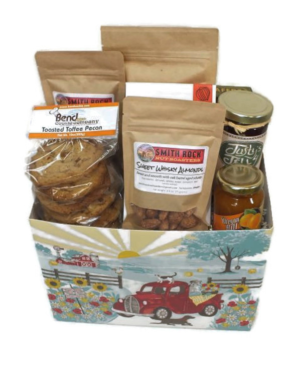 Central Oregon Holiday Offerings includes Tiramisu Wafer Roll cookies, Smith Rock Coffee - Misery Ridge Blend, Smith Rock Nuts Roasters - Sweet Whisky Almonds, Coconut Coffee Almonds, Holm Made Toffee Co.  Peppermint Toffee  Justy's Jelly Vanilla Peach Jelly, Bend Cookie Company Fresh Baked Cookies and McTavish Bakery peppermint shortread.  Designed in rustic holiday gift box.