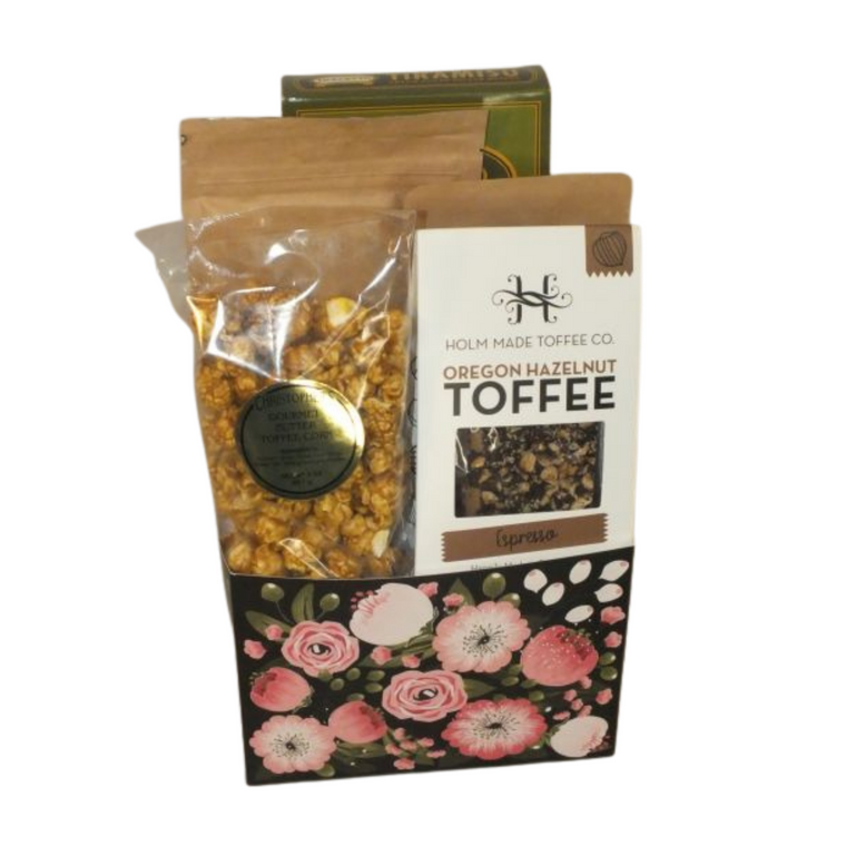 Moms Love Coffee includes Tiramisu cream filled wafer rolls, Smith Rock Coffee Roasters small batch Misery Ridge Blend, Smith Rock Nut Roasters Coconut Coffee Pecans, Espresso Chocolate Toffee and toffee popcorn.