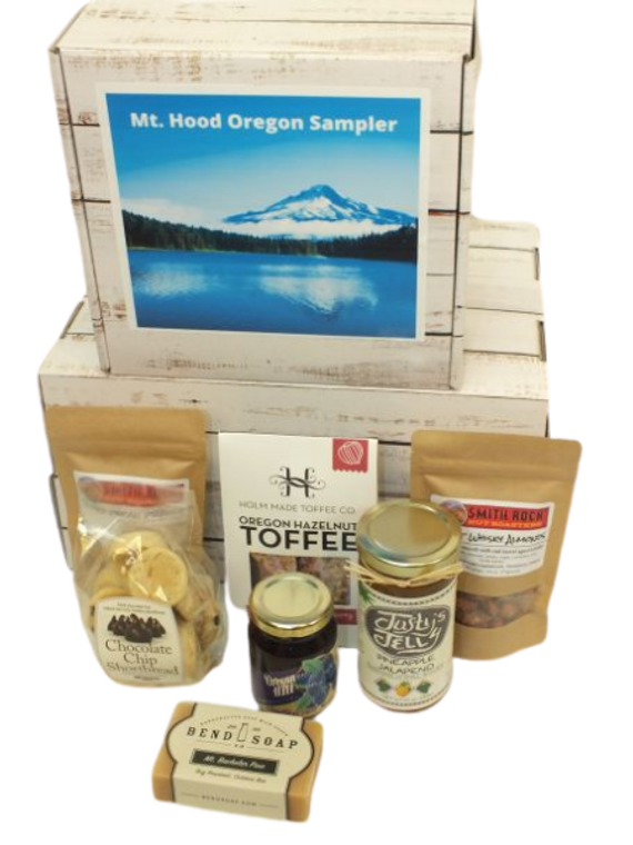 Mt. Hood Oregon Sampler includes Smith Rock Nut Roasters Toffee Pecan Praline, Sweet Whisky Almonds made with Pendleton whisky, Sea salt Chocolate Toffee, Chocolate chip shortbread cookies, Oregon Hill Farms marionberry jam, Justy's Jelly Pineapple Pepper Jelly and Bend Soap Company goats milk soap bar.  Designed in our Oregon Themed gift box.